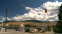 Drive plate, through small town in valley Stock Footage