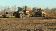 Construction, tractors working field Stock Footage
