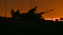 military, silhouetted armored fighting vehicle at sunset - stock footage