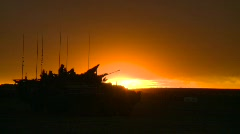 Military, silhouette armored fighting vehicle at sunset Stock Footage