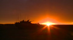military, silhouetted armored fight vehicle at sunset, #4 - stock footage