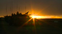 military, silhouetted armored fight vehicle at sunset, #2 - stock footage
