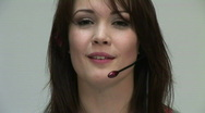 HD1080i Young brunette woman with headset Stock Footage