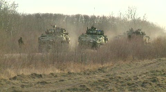 Stock Video Footage of  military, LAV3 in the distance going through checkpoint