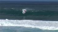 Guy surfs an awesome wave Stock Footage