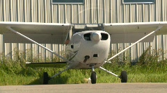 aircraft, Cessna 172 idle, head on ground angle - stock footage