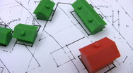 Red and green model houses on a real estate housing plan. Stock Footage
