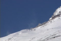 Snow blowing fast over Mountain Stock Footage