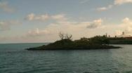 Cruising on open ocean, island Stock Footage