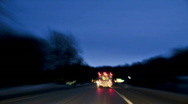 Stock Video Footage of Time-lapsed drive behind an ambulance on a rural road. hd