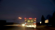 Stock Video Footage of Time-lapsed drive behind an ambulance with town lights. dv