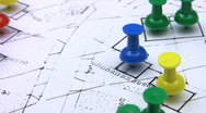 Map pins on a rotating real estate housing plan. Stock Footage