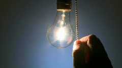 Hanging light bulb cu on 6b rev Stock Footage