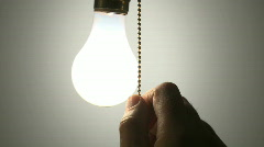 Hanging light bulb cu switched on 9b - stock footage