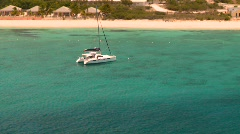 Sailboat in tropic bay Stock Footage