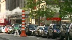 New York City, traffic, steam pipe, medium shot Stock Footage