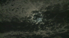 Moon behind clouds time lapse Stock Footage