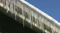 Rooftop Icicles. - stock footage