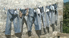 Jeans trousers drying - stock footage