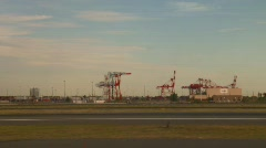 Runway and distant industry, aboard jet Stock Footage