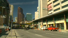 Downtown traffic and building construction Calgary, Alberta Stock Footage