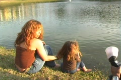 Mother and Daughter at a Pond-12 - stock footage