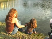 Stock Video Footage of Mother and Daughter at a Pond-12