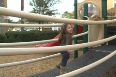Little Girl on a Playground (2) - stock footage