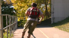 Fitness, roller blading on bike path, #1 Stock Footage