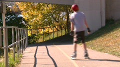 Fitness, bike path in autumn, #3 anonymous rollerbladers through Stock Footage