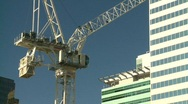 Stock Video Footage of construction crane, medium with office tower