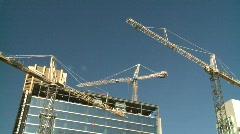 Construction crane tilt down to intermodal train Stock Footage