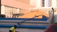 Construction site backhoe dumptruck Stock Footage