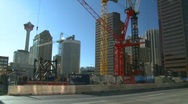 Construction site and traffic, The Bow (58 stories) at ground level Stock Footage