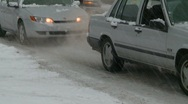 Stock Video Footage of snowy winter traffic, spinning tires, frustratingly slow