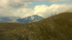 Snow topped mountain and the desert Stock Footage