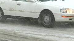 snowy winter traffic, spinning tires, all-season tires in icy conditions - stock footage