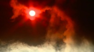 Stock Video Footage of cloud obscured sun, steam from industrial plant