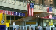 Flag, US flags, #9 and sign in airport Stock Footage