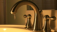 Wide shot of faucet Stock Footage
