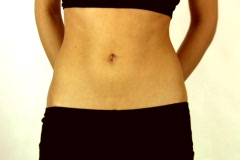 Slim young woman measuring her belly Stock Footage
