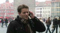 HD1080i Young Attractive Man talking on Mobile Phone in the city Stock Footage