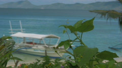 Traditional Filipino Banka outrigger boat next to a a beach in Philippines Stock Footage