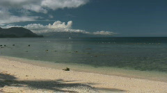 Sand beach with high mountains in the background in Philippines Stock Footage
