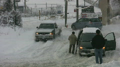 Pickup conquers snowy hill. - stock footage