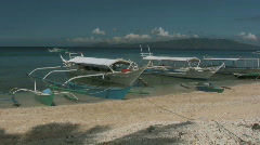 Traditional Filipino banka outrigger laying on a beach in Philippines Stock Footage