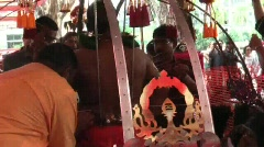 Removing mini milk jugs from devotee's body during Thaipusam Festival Stock Footage