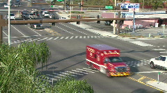 Ambulance Crosses Intersection Stock Footage