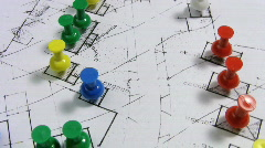 Map pins on a rotating housing real estate plan. Stock Footage