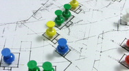 Stock Video Footage of Map pins on a rotating real estate housing plan.